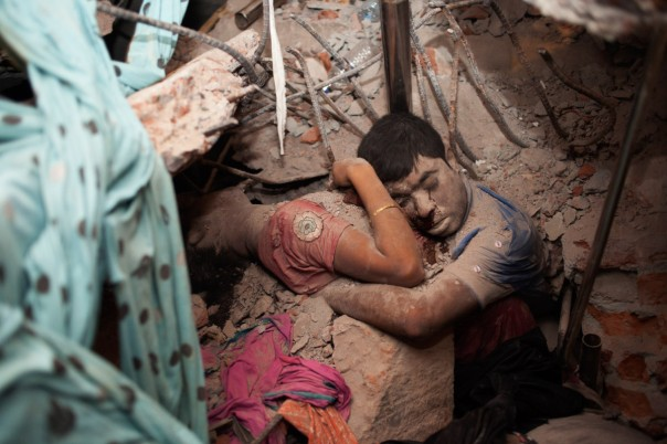 April 25, 2013. Two victims amid the rubble of a garment factory building collapse in Savar, near Dhaka, Bangladesh. (© Taslima Akhter